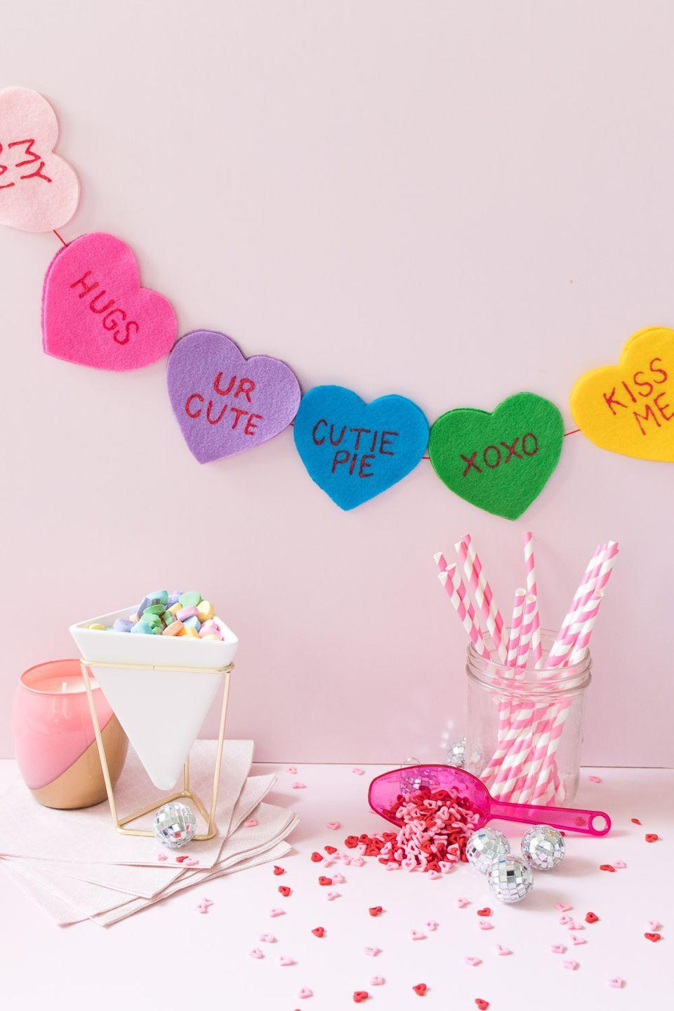 "<p>When you give store-bought candy hearts, you're limited to the messages in the box. But make this charming felt conversation heart banner with any custom messages you like. </p><p><em><a href=""https://www.clubcrafted.com/diy-felt-conversation-heart-banner-for-valentines-day/"" rel=""nofollow noopener"" target=""_blank"" data-ylk=""slk:Get the how-to at Club Crafted»"" class=""link rapid-noclick-resp"">Get the how-to at Club Crafted»</a></em><br></p>"