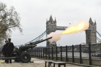 Members of the Honourable Artillery Company fire a 41-round gun salute from the wharf at the Tower of London, to mark the death of Prince Philip, in London, Saturday, April 10, 2021. Britain's Prince Philip, the irascible and tough-minded husband of Queen Elizabeth II who spent more than seven decades supporting his wife in a role that mostly defined his life, died on Friday. (Dominic Lipinski/PA via AP)