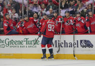 Washington Capitals Evgeny Kuznetsov (92) celebrates with teammates on the bench after scoring during the second period against the Ottawa Senators in an NHL hockey game Tuesday, Feb. 27, 2018, in Washington. (AP Photo/Pablo Martinez Monsivais)