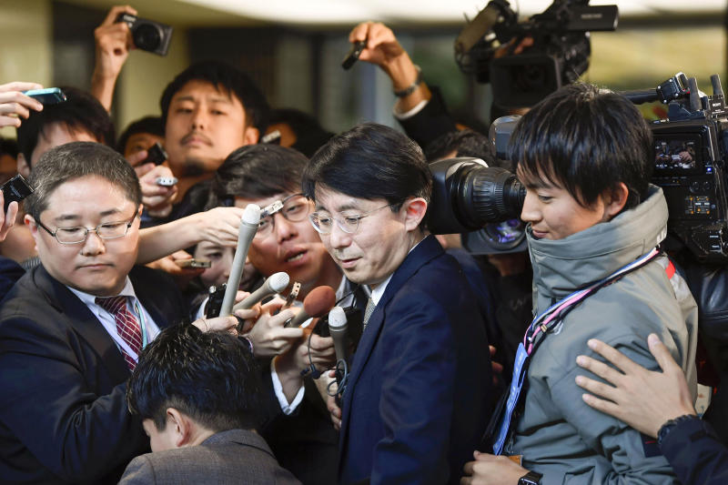 South Korean Foreign Ministry's Director-General for Asian and Pacific Affairs, Kim Jung-han, center, is mobbed by reporters as he leaves Foreign Ministry after meeting with Japanese officials in Tokyo Friday, Nov. 15, 2019. Japanese and South Korean diplomats met to discuss broad issues, including a plan by Seoul to scrap the General Security of Military Information Agreement, or GSOMIA, an intelligence-sharing arrangement that symbolized three-way security cooperation with Washington over the North Korean nuclear threat and China's growing regional influence. It is due to expire in late November. (Ren Onuma/Kyodo News via AP)