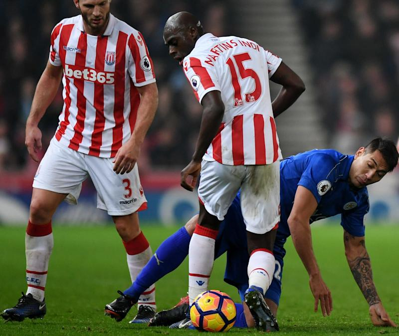 """Britain Football Soccer - Stoke City v Leicester City - Premier League - bet365 Stadium - 17/12/16 Leicester City's Leonardo Ulloa in action with Stoke City's Erik Pieters (L) and Bruno Martins Indi as Leicester City's Daniel Amartey and Stoke City's Joe Allen look on Reuters / Anthony Devlin Livepic EDITORIAL USE ONLY. No use with unauthorized audio, video, data, fixture lists, club/league logos or """"live"""" services. Online in-match use limited to 45 images, no video emulation. No use in betting, games or single club/league/player publications. Please contact your account representative for further details - Credit: Anthony Devlin/Reuters"""