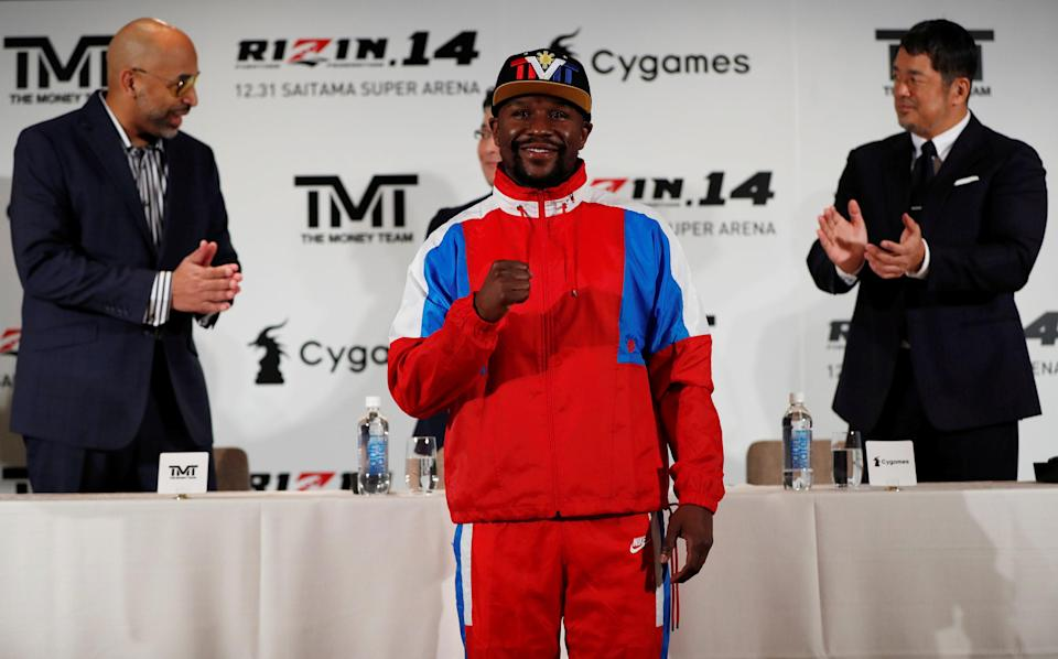 Undefeated boxer Floyd Mayweather Jr. attends a news conference on Nov. 5, 2018 in Tokyo to announce he is joining Japanese mixed martial arts promotional company Rizin Fighting Federation. (Reuters)