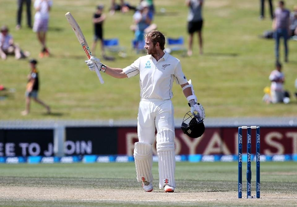 Kane Williamson of New Zealand celebrates his century during day four of the second Test against Sri Lanka at Seddon Park in Hamilton on December 21, 2015 (AFP Photo/Michael Bradley)