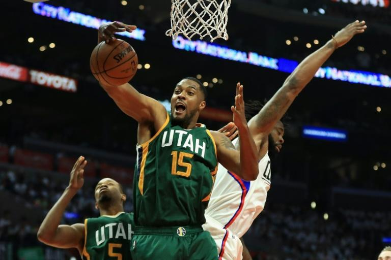 Derrick Favors (C) of the Utah Jazz battles DeAndre Jordan of the Los Angeles Clippers for a rebound on April 30, 2017