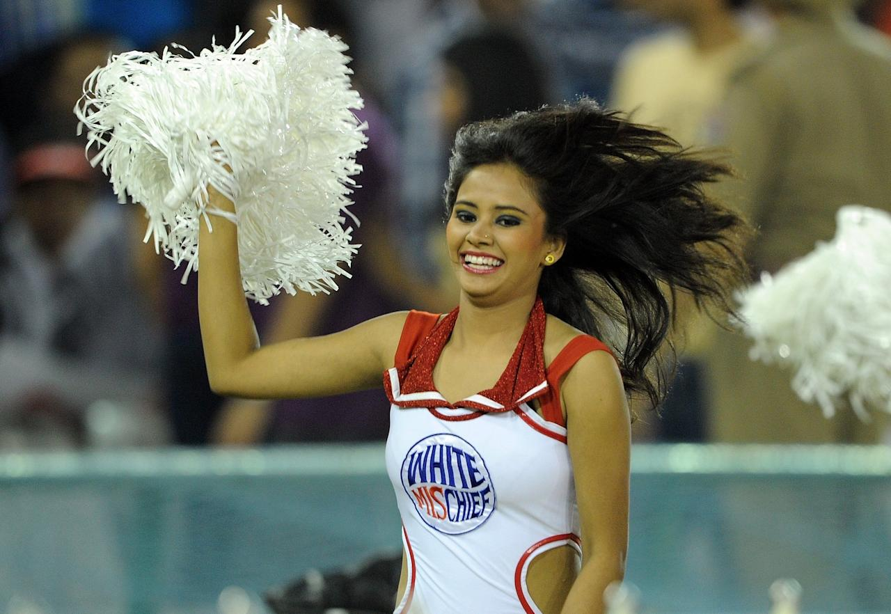 A Kings XI Punjab cheerleader performs prior to the IPL Twenty20 cricket match between Kings XI Punjab and Kolkata Knight Riders at PCA Stadium in Mohali on April 18, 2012.  RESTRICTED TO EDITORIAL USE. MOBILE USE WITHIN NEWS PACKAGE    AFP PHOTO/ Prakash SINGH (Photo credit should read PRAKASH SINGH/AFP/Getty Images)