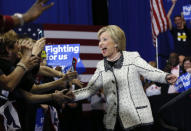 <p>Democratic presidential candidate Hillary Clinton arrives at her election night watch party for the South Carolina Democratic primary in Columbia, S.C., on Saturday. <i>(Photo: Gerald Herbert/AP)</i></p>