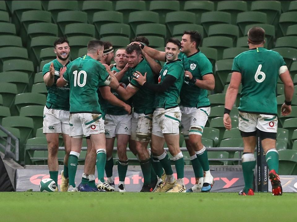 Ireland celebrate after Keith Earls score his second try of the match against Scotland (PA)