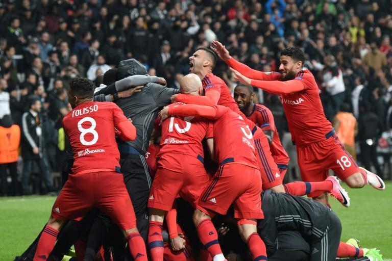 Lyon's players celebrate their victory at the end of the UEFA Europa League second leg quarter final football match against Besiktas April 20, 2017