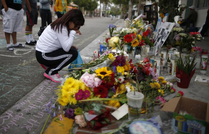 Sarabia cries in front of a makeshift shrine for 20-year-old UCSB student Michael-Martinez outside deli in Isla Vista neighborhood