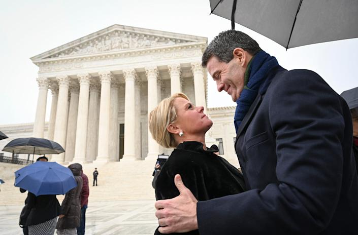 Bridget Kelly, former deputy chief of staff for New Jersey Gov. Chris Christie, and Bill Baroni, his top appointee at the Port Authority of New York and New Jersey, embrace outside the Supreme Court after oral argument Jan. 14.