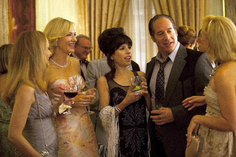 "In this film image released by Sony Pictures Classics shows, from second left, Cate Blanchette, Sally Hawkins, and Andrew Dice Clay in a scene from the Woody Allen film, ""Blue Jasmine."" ""Blue Jasmine,"" ""Nebraska"" and ""American Hustle"" have been nominated for Writers Guild honors, continuing their imprint on Hollywood's awards season. The three comedies gained nods on Friday, Jan. 3, 2014, for exceptional screen writing. (AP Photo/Sony Pictures Classics)"