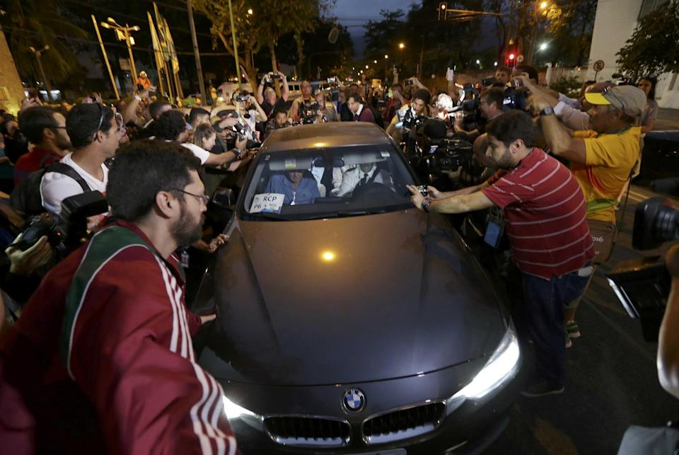 Reporters mob a car carrying American swimmers Jack Conger and Gunnar Bentz. (Reuters)