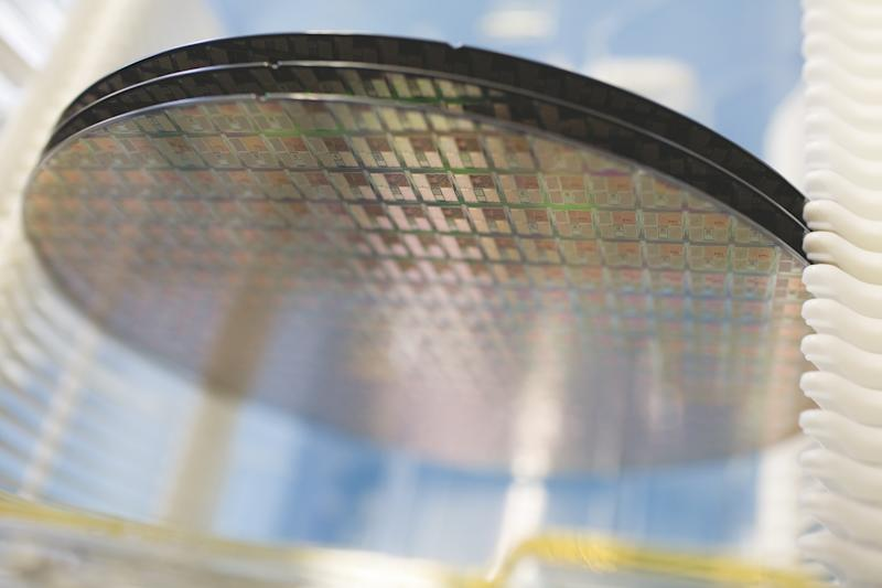 Several semiconductor wafers stacked on top of one another.