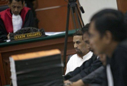 Indonesian Muslim militant and suspected Bali bomber Umar Patek (C) sits listening to a witness at his trial in Jakarta on April 12, 2012. Patek, 45, went on trial in February, charged with murder, bomb-making and illegal firearms possession