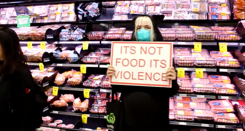 A Direct Action Everywhere protester stands in front of the meat aisle in a Countdown in Auckland's St Lukes on Sunday.
