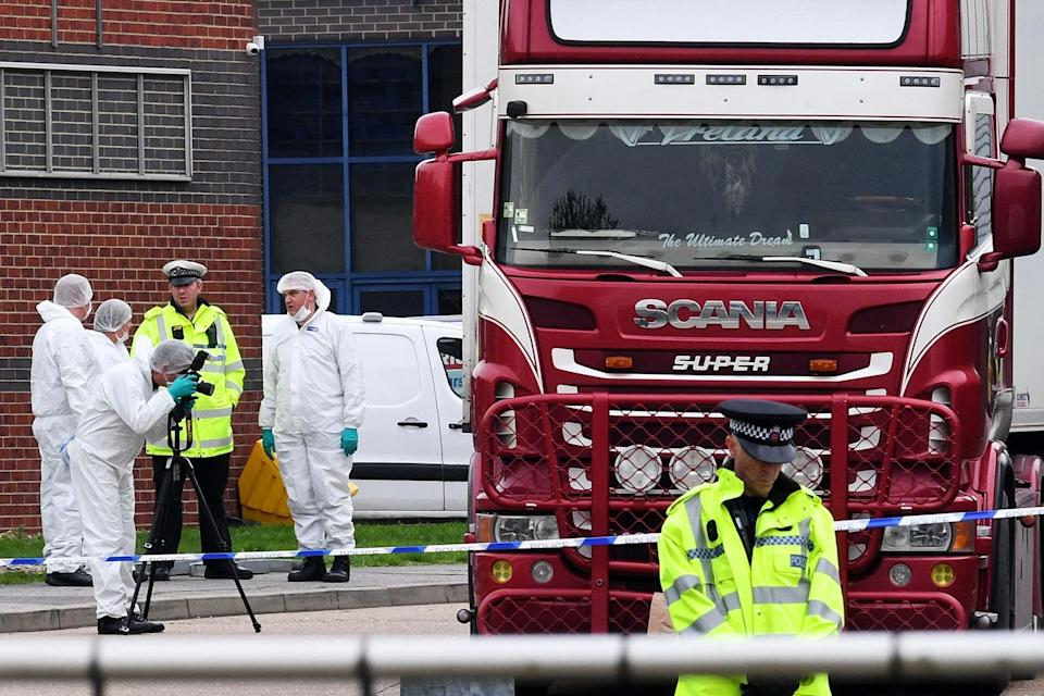 Police and forensic officers investigating the lorry (Getty Images)