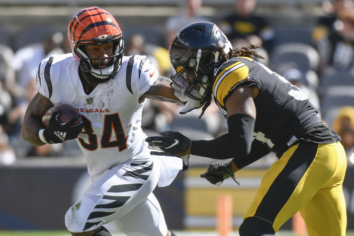 Cincinnati Bengals running back Samaje Perine (34) tries to evade Pittsburgh Steelers strong safety Terrell Edmunds (34) during the second half an NFL football game, Sunday, Sept. 26, 2021, in Pittsburgh. (AP Photo/Don Wright)