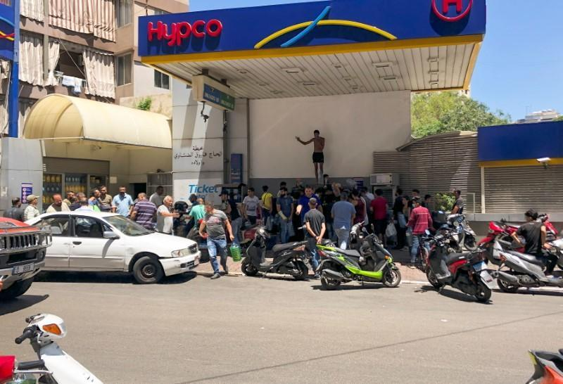 People queue for fuel at a gas station in Beirut