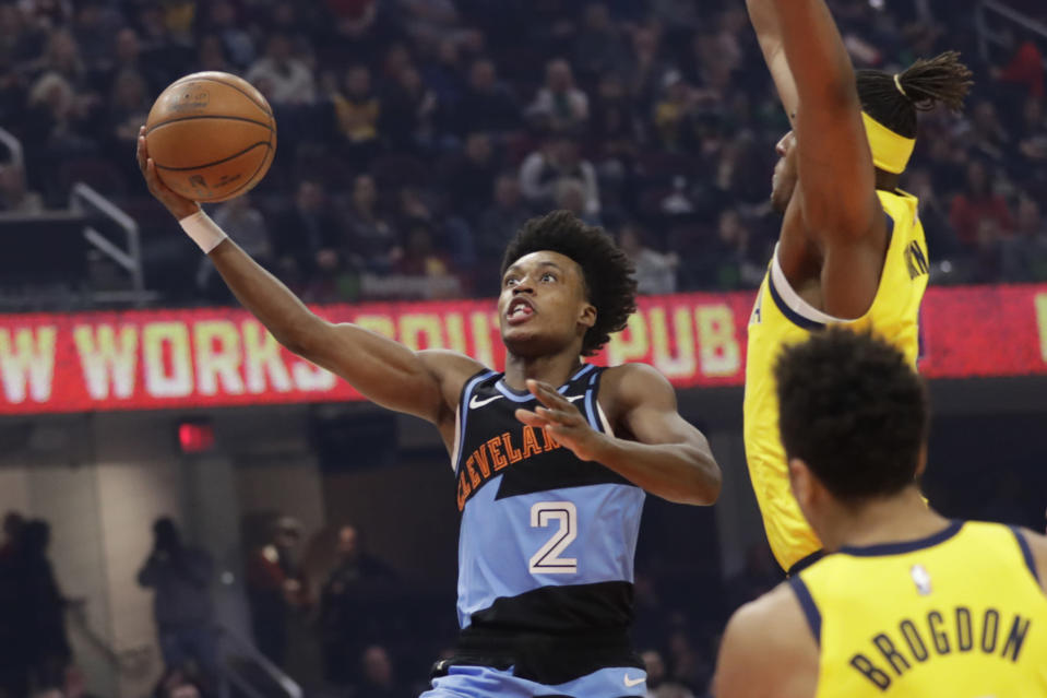 Cleveland Cavaliers' Collin Sexton (2) drives to the basket against the Indiana Pacers in the first half of an NBA basketball game, Saturday, Feb. 29, 2020, in Cleveland. (AP Photo/Tony Dejak)