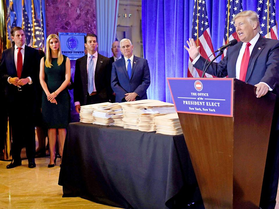 trump press conference pile of papers
