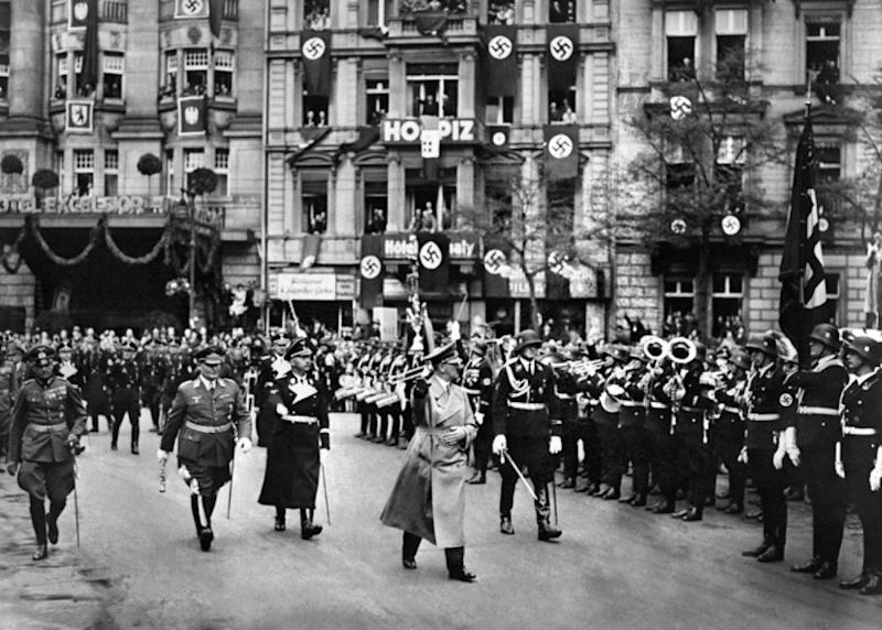 An undated picture shows nazi Chancellor Adolf Hitler followed by commander-in-chief Hermann Goering (2nd L) and head of the SS Heinrich Himmler (3rd L) marching in Berlin next to the hotel Excelsior which was Hitler's base in the city in the early 1930s. AFP PHOTO (Photo credit should read -/AFP/Getty Images)