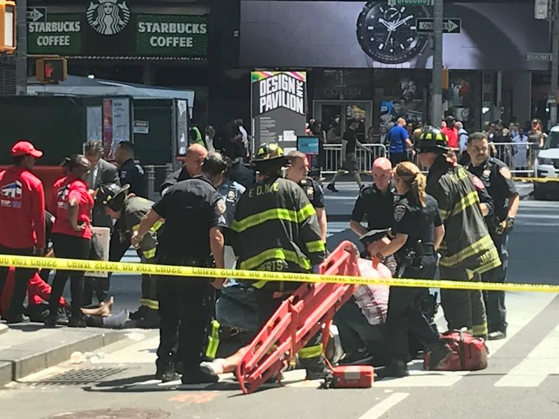 Emergency services attend the scene in Times Square where a car has struck pedestrians, killing one (Reuters)