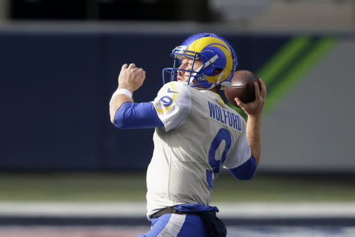 Los Angeles Rams quarterback John Wolford warms-up before an NFL wild-card playoff football game against the Seattle Seahawks, Saturday, Jan. 9, 2021, in Seattle. (AP Photo/Scott Eklund)