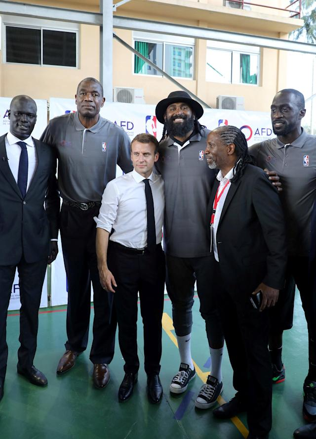 French President Emmanuel Macron and managing director of NBA Africa Amadou Gallo Fall (L) pose for a picture with former pro NBA Africa basketball players at the French Louis Pasteur high school in Lagos, Nigeria, July 4, 2018. Ludovic Marin/Pool via Reuters
