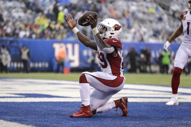 Arizona Cardinals' Chase Edmonds reacts after scoring during the second half of an NFL football game against the New York Giants, Sunday, Oct. 20, 2019, in East Rutherford, N.J. (AP Photo/Adam Hunger)