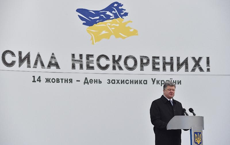 Ukrainian President Petro Poroshenko delivers a speech during the opening ceremony of a military exhibition in Kiev on October 14, 2015 to mark Defender's Day in Ukraine (AFP Photo/Genya Savilov)