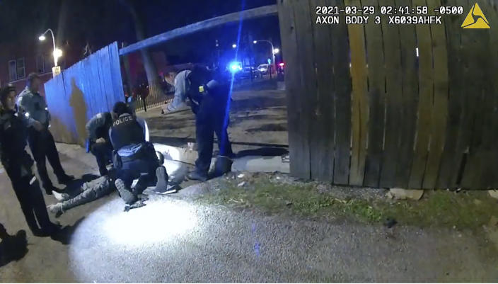 "FILE - This March 29, 2021 image from Chicago Police Department body cam video shows Chicago Police performing CPR on 13-year-old Adam Toledo after being shot by Chicago Police in Chicago. The gunshot detection system that set in motion the recent fatal police shooting of Toledo, a 13-year-old boy in Chicago routinely reports gunshots where there are none, sending officers into predominantly Black and Latino neighborhoods for ""unnecessary and hostile"" encounters, community groups argued in a court filing Monday May 3, 2021. (Chicago Police Department via AP)"