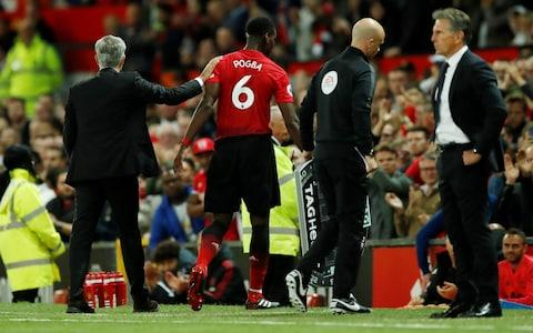 Soccer Football - Premier League - Manchester United v Leicester City - Old Trafford, Manchester, Britain - August 10, 2018 Manchester United's Paul Pogba with Manchester United manager Jose Mourinho after being substituted Action Images via Reuters/Andrew Boyers - Credit: Action Images