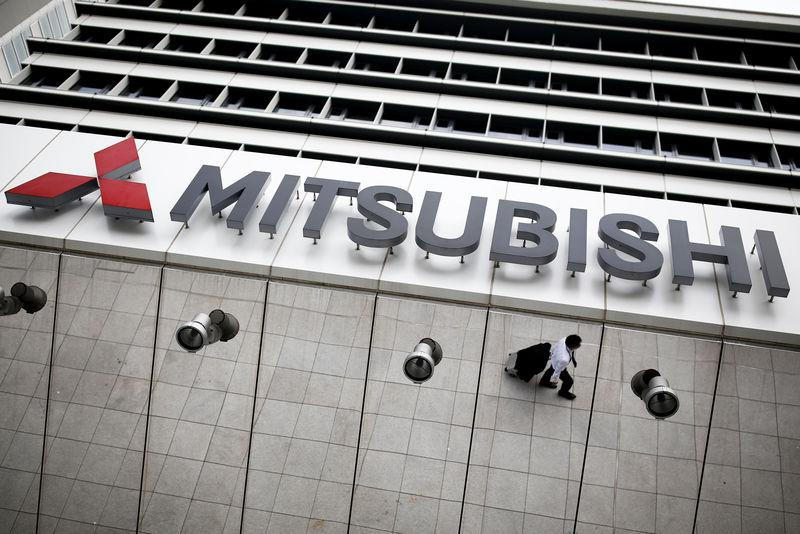 The company logo of Mitsubishi Motors is seen at it's headquarters in Tokyo