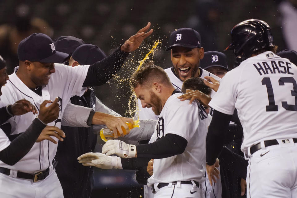 Detroit Tigers' Robbie Grossman is greeted by teammates after a two-run walk-off home run during the 10th inning of a baseball game against the New York Yankees, Friday, May 28, 2021, in Detroit. (AP Photo/Carlos Osorio)