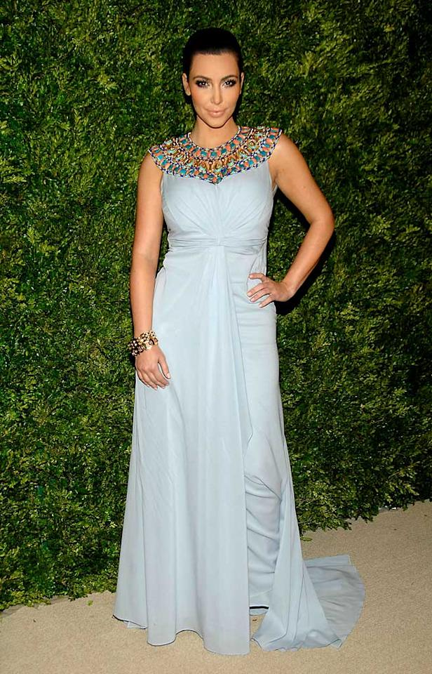 """Meanwhile, Kim Kardashian looked like an Egyptian queen in her blue Zac Posen gown. She and her older sister Kourtney really are taking Manhattan! Ben Gabbe/<a href=""""http://www.gettyimages.com/"""" target=""""new"""">GettyImages.com</a> - November 15, 2010"""