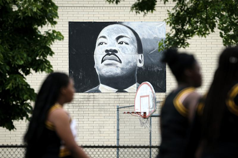 MILWAUKEE, WISCONSIN - JUNE 19: The parade passes by a painting of Martin Luther King Jr. during the 48th Annual Juneteenth Day Festival on June 19, 2019 in Milwaukee, Wisconsin. (Photo by Dylan Buell/Getty Images for VIBE)