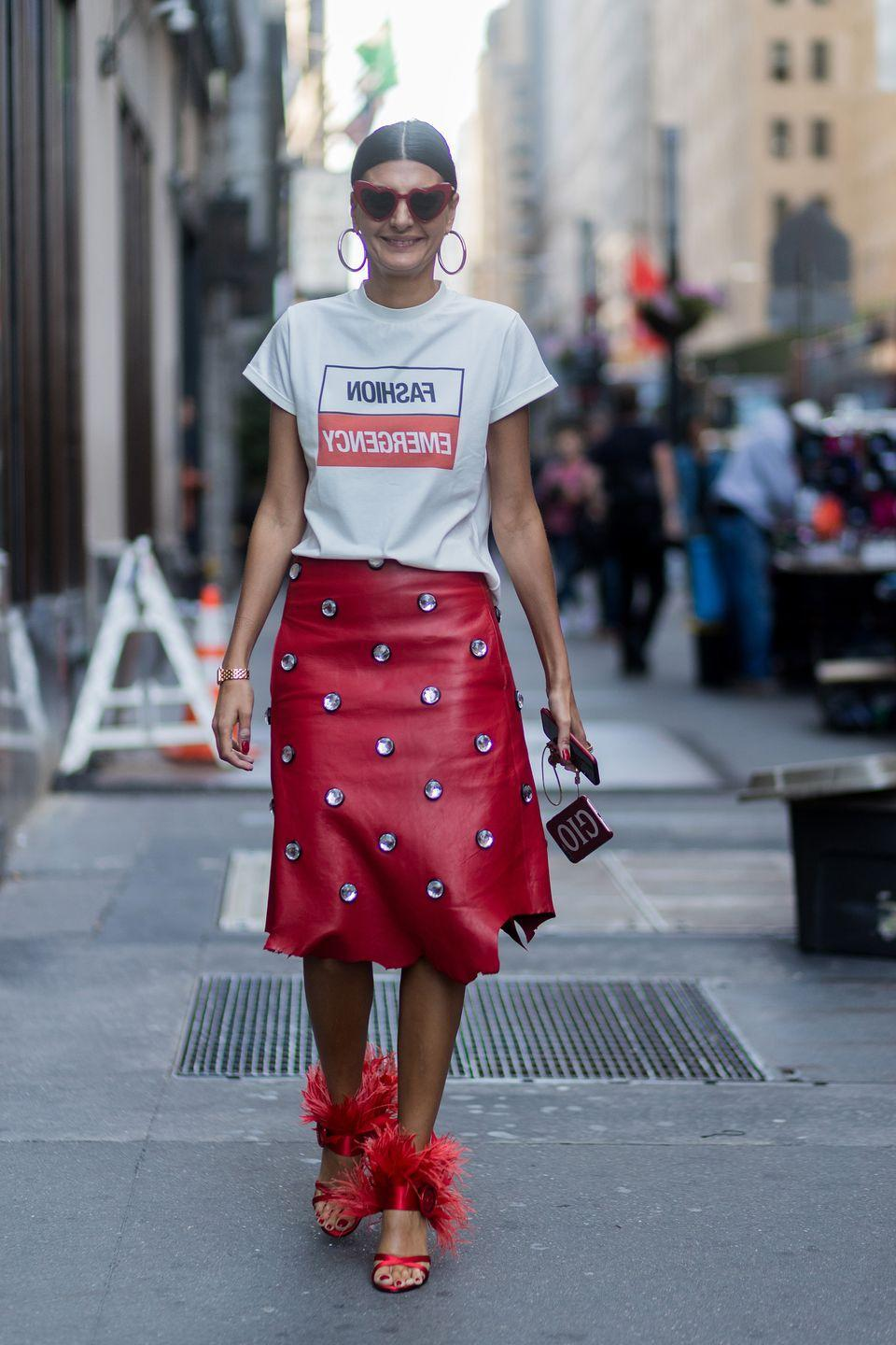 <p>Give leather a daytime feel by styling with a simple slogan T-shirt like Battaglia in September 2017. </p>