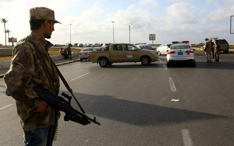 Forces loyal to Libya's Government of National Accord man a checkpoint in the Hay al-Andalus neighbourhood of Tripoli in March 2017