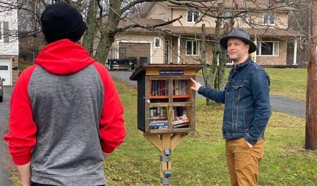 Last year someone broke the glass in Keith Burgoyne's little library, but a local business stepped up to fix it.