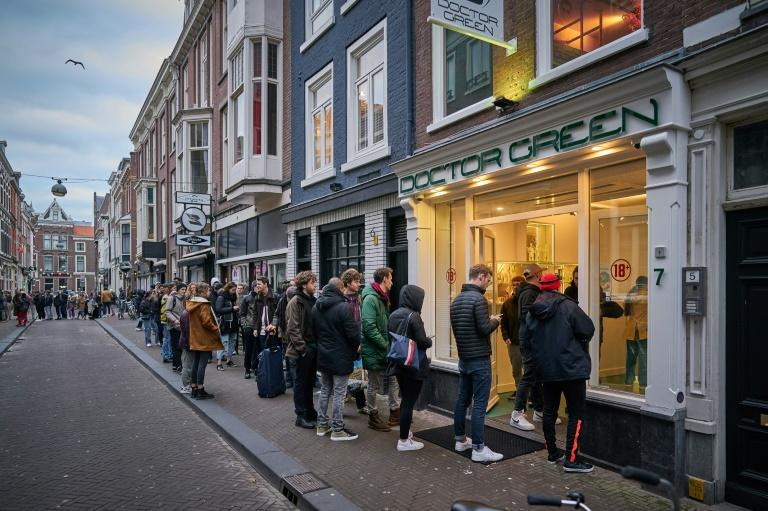 People queue outside cannabis cafe in The Hague on Sunday