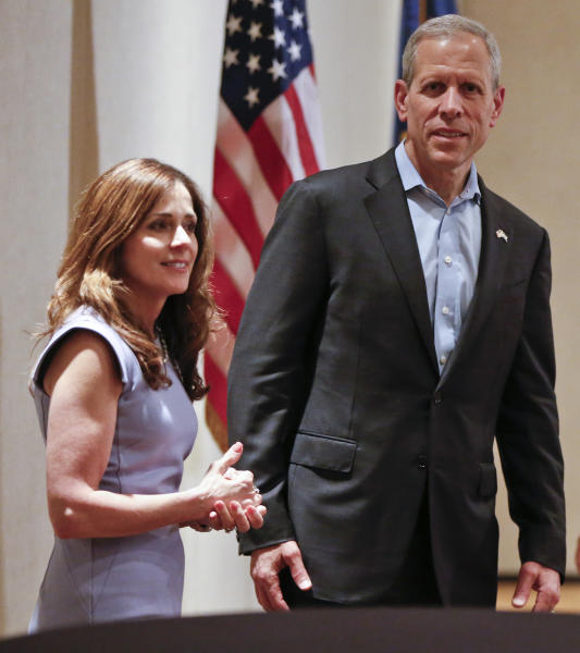 Paul Mango, right, Republican candidate for Pennsylvania Governor, attends a campaign rally with lieutenant governor candidate Diana Vaughn, in Canonsburg, Pa., Monday, May 14, 2018, a day before the Pennsylvania primary where he faces two other Republicans, Scott Wagner and Laura Ellsworth. (AP Photo/Keith Srakocic)