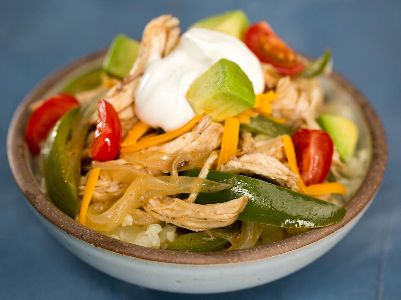 """<p>This keto-approved take on fajitas is a super satisfying low-carb meal. The chicken shreds off the bone easily, while the veggies have a slight crunch and the broth is light and flavorful. It feels indulgent, but you're not breaking any rules. </p> <p><a href=""""https://www.myrecipes.com/recipe/instant-pot-keto-fajita-bowls"""">Instant Pot Keto Chicken Fajita Bowls&nbsp; Recipe</a></p>"""
