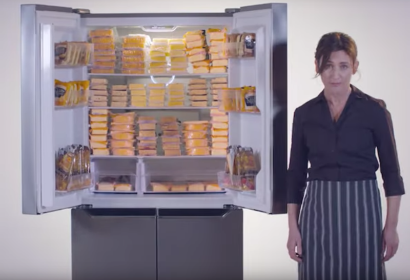 Cafe owner describing the Aldi French door fridge in the promotional video.