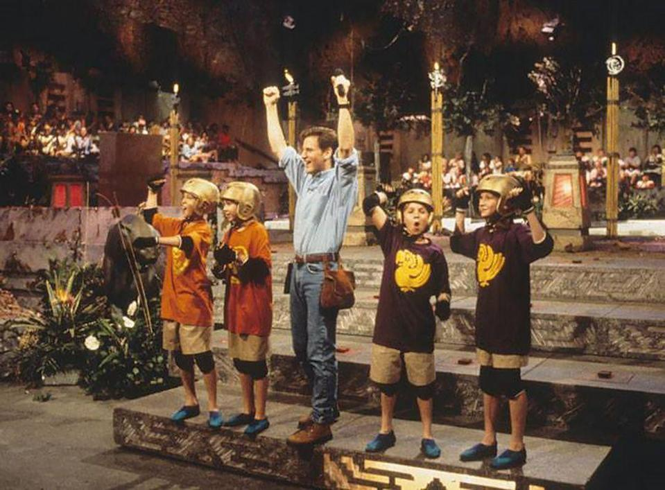 """<p>It doesn't matter how old you are, pulling costume inspiration from your favorite childhood shows can always be a good idea if done right. And with this 'Legends of the Hidden Temple' costume idea, you and your BFF could totally win the game.</p><p><b>What You'll Need</b>: A <a href=""""https://www.amazon.com/Legends-Tribute-Halloween-Costume-T-shirt-S-Silver/dp/B00IMIIFOU/ref=pd_di_v2_sccai_1/143-1131725-9809017?_encoding=UTF8&pd_rd_i=B07KBDD3VZ&pd_rd_r=c1d6ffa4-1318-4c82-bc63-ae54ca6e4577&pd_rd_w=d8GES&pd_rd_wg=q6KtW&pf_rd_p=47579771-02b9-4db9-aad8-9d98476f87cf&pf_rd_r=1Q1B03Y1N1V2XMP8TD8C&psc=1&refRID=1Q1B03Y1N1V2XMP8TD8C"""" rel=""""nofollow noopener"""" target=""""_blank"""" data-ylk=""""slk:player shirt"""" class=""""link rapid-noclick-resp"""">player shirt</a> ($14, Amazon); <a href=""""https://www.amazon.com/UNIONBAY-Womens-Darcy-Stretch-Inseam/dp/B019FHF6UM/ref=sr_1_3?dchild=1&keywords=women%27s%2Bkhaki%2Bshorts&qid=1594898653&s=apparel&sr=1-3&th=1&psc=1"""" rel=""""nofollow noopener"""" target=""""_blank"""" data-ylk=""""slk:khaki shorts"""" class=""""link rapid-noclick-resp"""">khaki shorts</a> ($20, Amazon); a <a href=""""https://www.amazon.com/Helmet-Legends-Hidden-Temple-Costume/dp/B00FH40CR0/ref=sr_1_4?dchild=1&keywords=gold+helmet&qid=1594898720&s=apparel&sr=1-4"""" rel=""""nofollow noopener"""" target=""""_blank"""" data-ylk=""""slk:gold helmet"""" class=""""link rapid-noclick-resp"""">gold helmet</a> ($15, Amazon)</p>"""