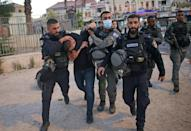 Israeli police detain a Palestinian near Damascus Gate to clear the route of a controversial march into annexed east Jerusalem by Jewish ultranationalists