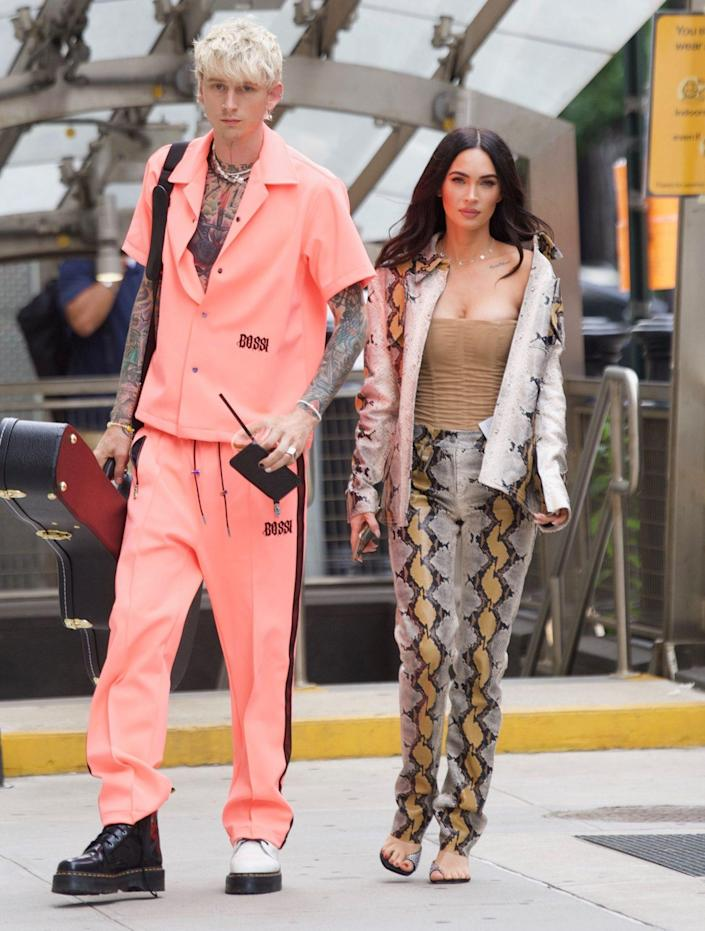 <p>Machine Gun Kelly and Megan Fox head out in N.Y.C. on Sept. 15 following his sold-out show. </p>