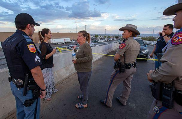 PHOTO: Edie Hallberg, center, speaks with police officers outside the Walmart store as she's looking for her missing mother Angie Englisbee, 87, who was in the store during the shooting in El Paso, Texas, Aug. 3, 2019. (Andres Leighton/AP)