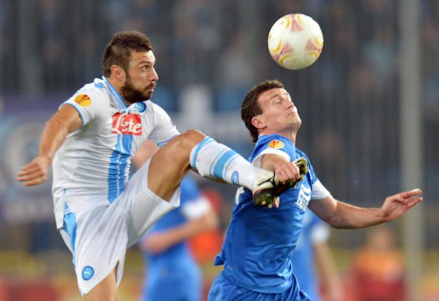 Andrea Dossena (L) of SSC Napoli fights for a ball with Artem Fedetskiy (R) of FC Dnipro during UEFA Europa League, Group F, football match in Dnipropetrovs on October 25, 2012. AFP PHOTO/ SERGEI SUPINSKYSERGEI SUPINSKY/AFP/Getty Images