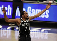 Brooklyn Nets forward Kevin Durant reacts against the Milwaukee Bucks during the first half of an NBA basketball game Monday, Jan. 18, 2021, in New York. (AP Photo/Adam Hunger)