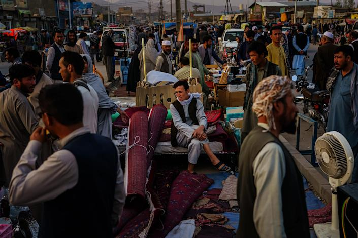 Afghans sell their personal belongings to raise money, citing unemployment, starvation and needing it leave the country, in Kabul on Sept. 20, 2021.